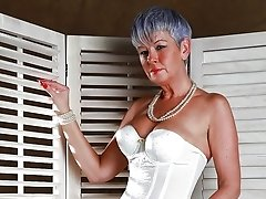 Grey hair granny in very sexy old style lingerie wish a cock