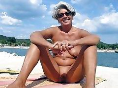 Granny naturist show her old pussy on the beach