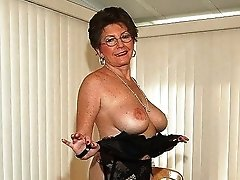 Sexy big breasted granny with glasses and lingerie