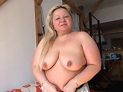Blonde chubby mature spreading her shaved pussy lips